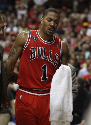 INDIANAPOLIS, IN - APRIL 23: Derrick Rose #1 of the Chicago Bulls walks off of the court after injuring his ankle against the Indiana Pacers in Game Four of the Eastern Conference Quarterfinals in the 2011 NBA Playoffs at Conseco Fieldhouse on April 23, 2