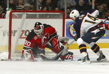EAST RUTHERFORD, NJ - DECEMBER 19:  Goaltender Martin Broduer #30 of the New Jersey Devils gives up a second period goal to Jon Sims #14 of the Atlanta Thrashers on December 19, 2006 at the Continental Airlines Arena in East Rutherford, New Jersey.  (Phot