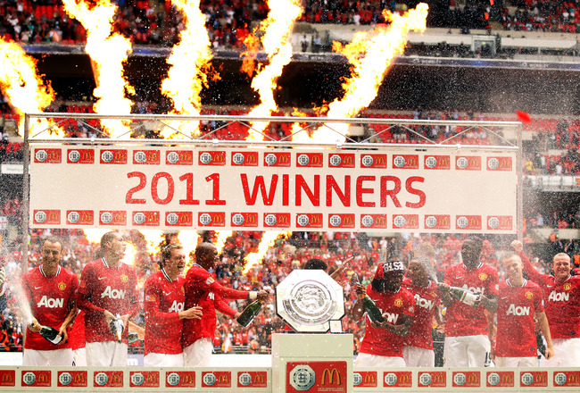 LONDON, ENGLAND - AUGUST 07:  The Manchester United team celebrate victory with the Community Shield after the FA Community Shield match sponsored by McDonald's between Manchester City and Manchester United at Wembley Stadium on August 7, 2011 in London,