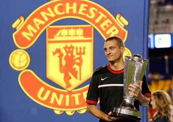 HARRISON, NJ - JULY 27:  Nemanja Vidic #15 of the Manchester United celebrates with the trophy after defeating the MLS All-Stars 4-0 during the MLS All-Star Game at Red Bull Arena on July 27, 2011 in Harrison, New Jersey.  (Photo by Mike Stobe/Getty Image