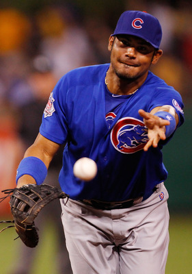 PITTSBURGH - AUGUST 01:  Carlos Pena #22 of the Chicago Cubs tosses a ball to first base against the Pittsburgh Pirates  during the game on August 1, 2011 at PNC Park in Pittsburgh, Pennsylvania.  (Photo by Jared Wickerham/Getty Images)