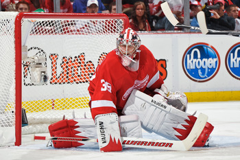 DETROIT - MAY 4: Goaltender Jimmy Howard #35 of the Detroit Red Wings guards the net against the San Jose Sharks in Game Three of the Western Conference Semifinals during the 2011 NHL Stanley Cup Playoffs on May 4, 2011 at Joe Louis Arena in Detroit, Mich