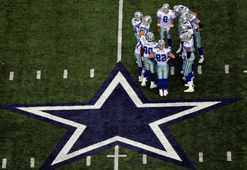 ARLINGTON, TX - NOVEMBER 01:  Quarterback Tony Romo #9 of the Dallas Cowboys huddles the offense during play against the Seattle Seahawks at Cowboys Stadium on November 1, 2009 in Arlington, Texas.  (Photo by Ronald Martinez/Getty Images)