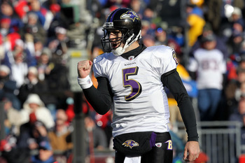 FOXBORO, MA - JANUARY 10:  Joe Flacco #5 of the Baltimore Ravens reacts after Ray Rice scored a 1-yard touchdown in the first quarter against the New England Patriots during the 2010 AFC wild-card playoff game at Gillette Stadium on January 10, 2010 in Fo