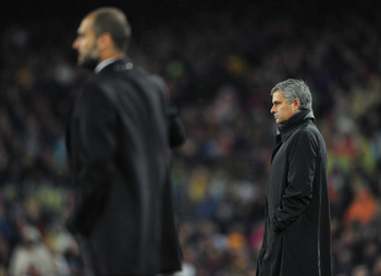 BARCELONA, SPAIN - NOVEMBER 29:  Head coach Jose Mourinho (R) of Real Madrid follows the game flanked by head coach Josep Guardiola of Barcelona during the la liga match between Barcelona and Real Madrid at the Camp Nou stadium on November 29, 2010 in Bar