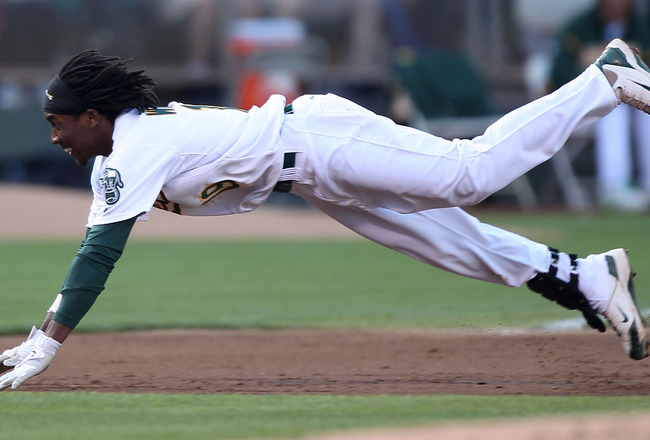 OAKLAND, CA - JULY 30:  Jemile Weeks #19 of the Oakland Athletics slides into third base with a triple in the second inning against the Minnesota Twins at O.co Coliseum on July 30, 2011 in Oakland, California.  (Photo by Jed Jacobsohn/Getty Images)