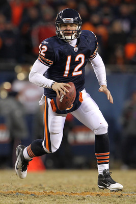 CHICAGO, IL - JANUARY 23:  Caleb Hanie #12 of the Chicago Bears looks to pass against the Green Bay Packers in the second half in the NFC Championship Game at Soldier Field on January 23, 2011 in Chicago, Illinois.  (Photo by Jamie Squire/Getty Images)