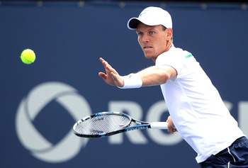 MONTREAL, QC - AUGUST 10:  Tomas Berdych of the Czech Republic returns a shot to Alexandr Dolgopolov of the Ukraine during the Rogers Cup at Uniprix Stadium on August 10, 2011 in Montreal, Canada.  (Photo by Matthew Stockman/Getty Images)