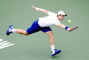MONTREAL, QC - AUGUST 09: Andy Murray of Great Britain lunges for a shot whilst playing Kevin Anderson of South Africa during the Rogers Cup at Uniprix Stadium on August 9, 2011 in Montreal, Canada.  (Photo by Matthew Stockman/Getty Images)