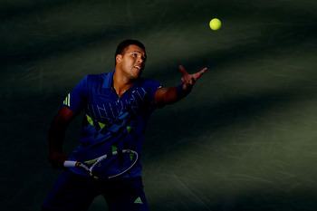 MONTREAL, QC - AUGUST 12:  Jo-Wilfried Tsonga of France serves to Nicolas Almagro of Spain during the Rogers Cup at Uniprix Stadium on August 12, 2011 in Montreal, Canada.  (Photo by Matthew Stockman/Getty Images)