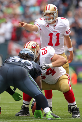 SEATTLE - SEPTEMBER 12:  Quarterback Alex Smith #11 of the San Francisco 49ers gestures during the NFL season opener against the Seattle Seahawks at Qwest Field on September 12, 2010 in Seattle, Washington. (Photo by Otto Greule Jr/Getty Images)