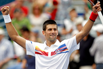 MONTREAL, QC - AUGUST 10:  Novak Djokovic of Serbia celebrates his win over Nikolay Davydenko of Russia during the Rogers Cup at Uniprix Stadium on August 10, 2011 in Montreal, Canada.  (Photo by Matthew Stockman/Getty Images)