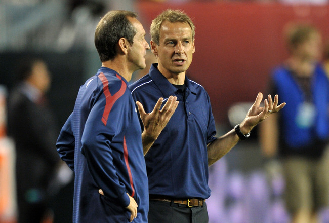 PHILADELPHIA, PA - AUGUST 10: Head coach Jurgen Klinsmann of the United States talks with former player Thomas Dooley before the game against  Mexico at Lincoln Financial Field on August 10, 2011 in Philadelphia, Pennsylvania. (Photo by Drew Hallowell/Get