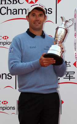 SHANGHAI, CHINA - NOVEMBER 06:  Padraig Harrington of Ireland holds the Open Championship Silver Claret Jug during the US Open Trophy during the preview day to the HSBC Champions Trophy at the Shanghai Exhibition Centre on November 6, 2007 in Shanghai, Ch
