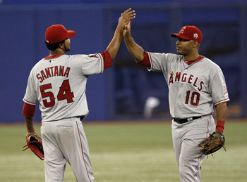 TORONTO, CANADA - AUGUST 12: Vernon Wells #10 and Ervin Santana #54 of the Los Angeles Angels of Anaheim celebrate the win against the Toronto Blue Jays during MLB action at the Rogers Centre August 12, 2011 in Toronto, Ontario, Canada. (Photo by Abelimag
