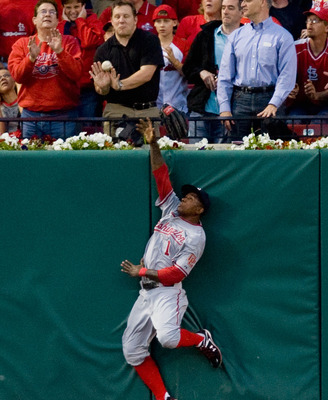 Nyger Morgan leaps for a catch while with the Washington Nationals