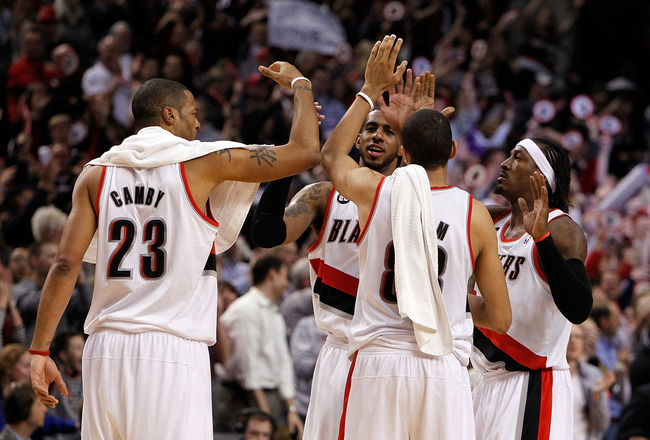PORTLAND, OR - APRIL 21:  LaMarcus Aldridge #12, Gerald Wallace #3, Nicolas Batum #88 and Marcus Camby #23 of the Portland Trail Blazers celebrates their 97-92 victory over the Dallas Mavericks in Game Three of the Western Conference Quarterfinals in the