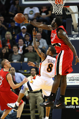 OAKLAND, CA - NOVEMBER 20:  Greg Oden #52 of the Portland Trail Blazers blocks a shot by Monta Ellis #8 of the Golden State Warriors during an NBA game at Oracle Arena on November 20, 2009 in Oakland, California.  (Photo by Jed Jacobsohn/Getty Images)