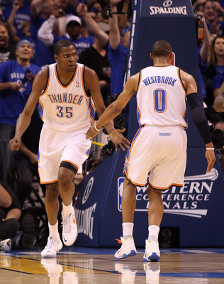OKLAHOMA CITY, OK - MAY 23:  Kevin Durant #35 and Russell Westbrook #0 of the Oklahoma City Thunder react in the first half while taking on the Dallas Mavericks in Game Four of the Western Conference Finals during the 2011 NBA Playoffs at Oklahoma City Ar