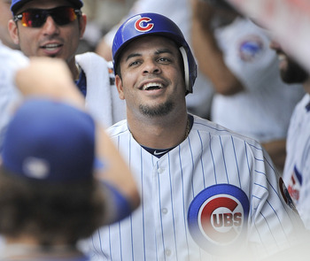 CHICAGO, IL - AUGUST 06:  Aramis Ramirez #16 of the Chicago Cubs smiles as he walks through the dugout after scoring on an RBI double hit by Carlos Pena during the third inning against the Cincinnati Reds at Wrigley Field on August 6, 2011 in Chicago, Ill