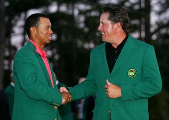 AUGUSTA, GA - APRIL 09:  Tiger Woods and Phil Mickelson shake hands at the green jacket presentation after Mickelson won The Masters at the Augusta National Golf Club after the final round on April 9, 2006 in Augusta, Georgia.  Mickelson won with the scor