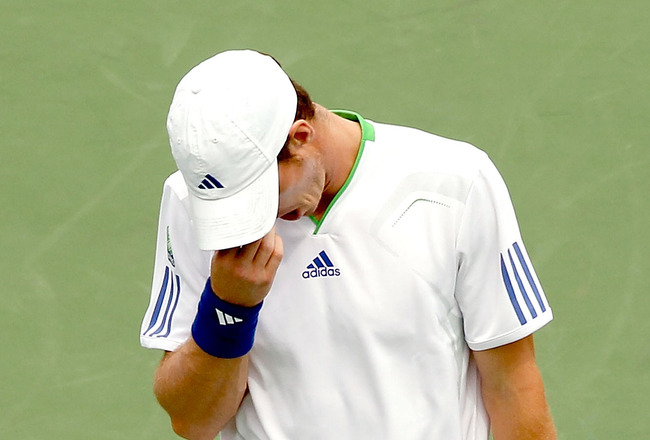 MONTREAL, QC - AUGUST 09:  Andy Murray of Great Britain wipes his forehead between points while playing Kevin Anderson of South Africa during the Rogers Cup at Uniprix Stadium on August 9, 2011 in Montreal, Canada.  (Photo by Matthew Stockman/Getty Images