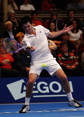 LONDON, ENGLAND - DECEMBER 04:  Tim Henman of Great Britain in action during the semi final match between Tim Henman and Todd Martin on day four of the AEGON Masters 2010 at the Royal Albert Hall on December 4, 2010 in London, England.  (Photo by Paul Gil