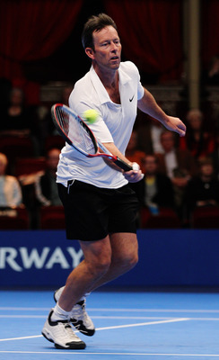 LONDON, ENGLAND - DECEMBER 02:  Jeremy Bates of Great Britain plays a backhand during the match between Jeremy Bates and Henri Leconte on day three of the AEGON Masters 2010 at the Royal Albert Hall on December 2, 2010 in London, England.  (Photo by Paul