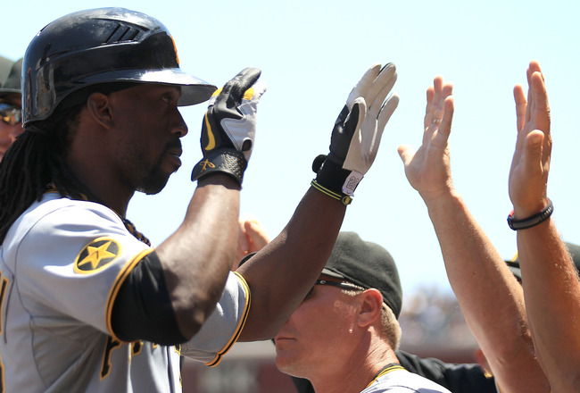 SAN FRANCISCO, CA - AUGUST 10:  Andrew McCutchen #22 of the Pittsburgh Pirates celebrates after hitting a two run home run in the third inning against the San Francisco Giants at AT&T Park on August 10, 2011 in San Francisco, California.  (Photo by Jed Ja