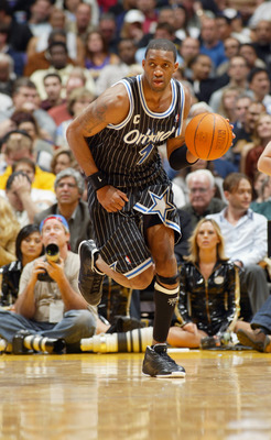 LOS ANGELES - MARCH 15:  Tracy McGrady  #1 of the Orlando Magic drives upcourt during the game against the Los Angeles Lakers at Staples Center on March 15, 2004 in Los Angeles, California.  The Lakers won 113-110.   NOTE TO USER: User expressly acknowled