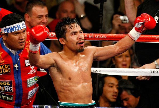 LAS VEGAS - DECEMBER 06:  Manny Pacquiao of the Philippines celebrates after defeating Oscar De La Hoya in their welterweight fight at the MGM Grand Garden Arena December 6, 2008 in Las Vegas, Nevada.  (Photo by Ethan Miller/Getty Images)