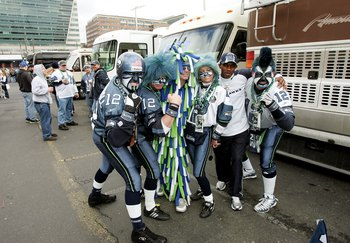 SEATTLE - JANUARY 22:  Seattle Seahawks tailgaters pose for the camera prior to the start of the NFC Championship Game between the Seattle Seahawks and the Carolina Panthers at Qwest Stadium on January 22, 2006 in Seattle, Washington.  (Photo by Harry How