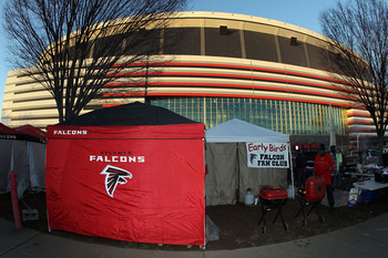 ATLANTA, GA - JANUARY 15:  A fan of the Atlanta Falcons cooks on the grill as he tailgates outside the stadium prior to the Falcons playing against the Green Bay Packers during their 2011 NFC divisional playoff game at Georgia Dome on January 15, 2011 in