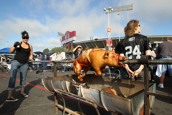 OAKLAND, CA - AUGUST 11:  Tailgaters roast a pig before the Arizona Cardinals preseason game against the Oakland Raiders at O.co Coliseum on August 11, 2011 in Oakland, California.  (Photo by Ezra Shaw/Getty Images)
