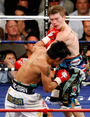LAS VEGAS - MAY 02:  (L-R) Manny Pacquiao of the Philippines knocks out Ricky Hatton of England with this left hook in the second round of their junior welterweight title fight at the MGM Grand Garden Arena May 2, 2009 in Las Vegas, Nevada. Pacquiao defea