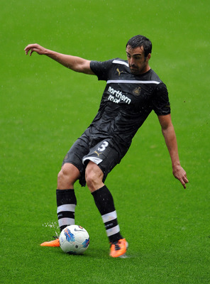 NEWCASTLE UPON TYNE, ENGLAND - AUGUST 06:  Jose Enrique of Newcastle United in action during the Pre Season Friendly between Newcastle United and Fiorentina at St James' Park on August 6, 2011 in Newcastle upon Tyne, England.  (Photo by Chris Brunskill/Ge