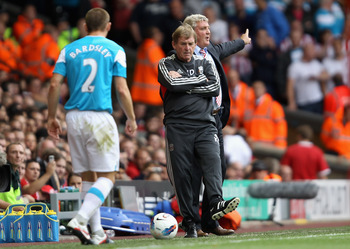LIVERPOOL, ENGLAND - AUGUST 13:  Liverpool manager Kenny Dalglish kicks the ball back to Phillip Bardsley of Sunderland during the Barclays Premier League match between Liverpool and Sunderland at Anfield on August 13, 2011 in Liverpool, England.  (Photo