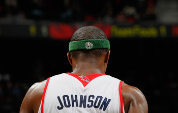ATLANTA, GA - APRIL 05:  Joe Johnson #2 of the Atlanta Hawks wears a headband promoting the NBA's recycling campaign during the game against the San Antonio Spurs at Philips Arena on April 5, 2011 in Atlanta, Georgia.  NOTE TO USER: User expressly acknowl