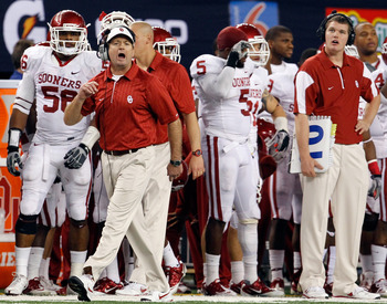 ARLINGTON, TX - DECEMBER 04:  Head coach Bob Stoops leads his team against the Nebraska Cornhuskers at Cowboys Stadium on December 4, 2010 in Arlington, Texas. The Sooners beat the Cornhuskers 23-20.  (Photo by Tom Pennington/Getty Images)