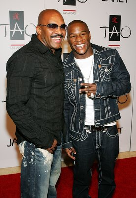 LAS VEGAS - SEPTEMBER 30:  Boxer Floyd Mayweather Jr. (R) and his advisor Leonard Ellerbe arrive at the Tao Nightclub at the Venetian Resort Hotel Casino during the club's one-year anniversary party September 30, 2006 in Las Vegas, Nevada.  (Photo by Etha