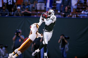26 Sep 1999:  Keyshawn Johnson #19 of the New York Jets catches the ball as Darrell Green #28 of the Washington Redskins tries to intercept it during the game at the Giants Stadium in East Rutherford, New Jersey. The Redskins defeated the Jets 27-20. Mand