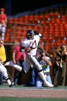 SAN FRANCISCO - OCTOBER 13:  Defensive back Deion Sanders #21 of the Atlanta Falcons looks back over his shoulder as he celebrates running the ball against the San Francisco 49ers during a game at Candlestick Park on October 13, 1991 in San Francisco, Cal