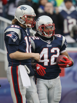 FOXBORO, MA - JANUARY 02:  Tom Brady #12 of the New England Patriots and BenJarvus Green-Ellis #42 celebrate the touchdown in the first half against the Miami Dolphins on January 2, 2011 at Gillette Stadium in Foxboro, Massachusetts.  (Photo by Elsa/Getty