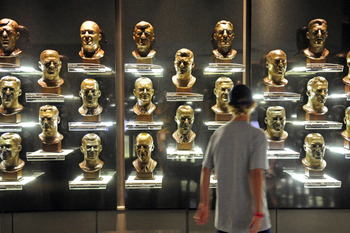 CANTON, OH - AUGUST 6:  A fan views the busts of former inductees prior to this year's induction ceremony at the Pro Football Hall of Fame on August 6, 2011 in Canton, Ohio.  (Photo by Jason Miller/Getty Images)