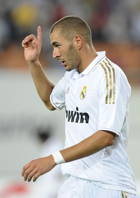 GUANGZHOU, CHINA - AUGUST 03:  Karim Benzema of Real Madrd celebrates after scoring his second goal  during the pre-season friendly match between Guangzhou Evergrande and Real Madrid at the Tianhe Stadium on August 3, 2011 in Guangzhou, China.  (Photo by