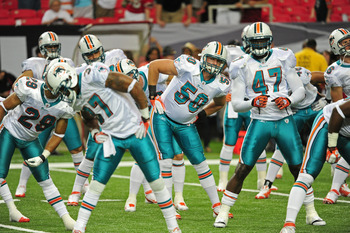 ATLANTA - AUGUST 12: Members of the Miami Dolphins stretch during warm-ups before their preseason game against the Atlanta Falcons at the Georgia Dome on August 12, 2011 in Atlanta, Georgia. (Photo by Scott Cunningham/Getty Images)