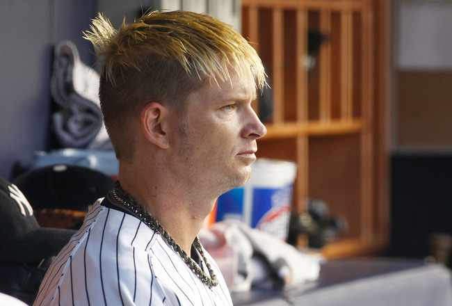 NEW YORK, NY - AUGUST 09:  A.J. Burnett #34 of the New York Yankees looks on from the bench during the game against the Los Angeles Angels of Anaheim on August 09, 2011 at Yankee Stadium in the Bronx borough of New York City.  (Photo by Mike Stobe/Getty I