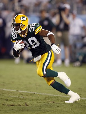 NASHVILLE, TN - AUGUST 30: Tramon Williams #38 of the Green Bay Packers returns a punt against the Tennessee Titans during a preseason game on August 30, 2007 at LP Field in Nashville, Tennessee. The Titans beat the Packers 30-14. (Photo by Joe Murphy/Get
