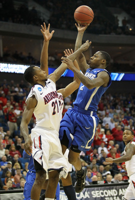 TULSA, OK - MARCH 18:  Antonio Barton #2 of the Memphis Tigers goes up for a shot against Kyle Fogg #21 of the Arizona Wildcats during the second round of the 2011 NCAA men's basketball tournament at BOK Center on March 18, 2011 in Tulsa, Oklahoma.  (Phot