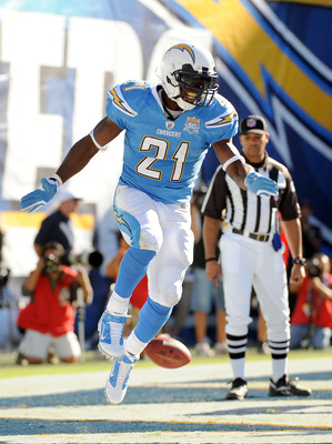 SAN DIEGO - NOVEMBER 01:  LaDainian Tomlinson #21 of the San Diego Chargers celebrates his second touchdown for a 21-7 lead over the Oakland Raiders during the second quarter at Qualcomm Stadium on November 1, 2009 in San Diego, California.  (Photo by Har